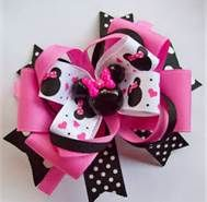 Minnie Mouse Boutique Hair Bow~ bet I could get alice to wear this one!