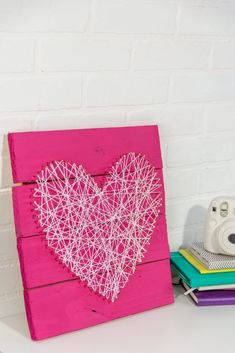 Today we're sharing with you exactly how to take scrap pieces of  wood from an old pallet to create this fun and easy DIY Valentine's Day pallet  string art project. #sponsored #valentines  #valentinesday #valentinesdaycrafts #valentinesdayprojects  #valentinesdaygiftideas #valentinesdaygifts #valentinesdaydiy #diyvalentinesday  #diyvalentinescrafts #diyvalentinesdecor #diyvalentinesdaydecor  #valentinesdaygifts