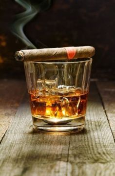 Burning Cuban cigar resting on a glass of brandy in a bar, the. - Personally whenever I smoke a cigar I feel like I am smarter. Gentlemen tend to smoke these on - Cigars And Whiskey, Good Cigars, Pipes And Cigars, Whiskey Gifts, Whiskey Glasses, Whiskey Bottle, Bourbon, Rum, Cigar Bar