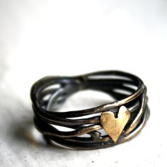 I Love Handmade: Nested Heart Ring in Sterling Silver by Rachel Pfeffer  This delightfully organic looking sterling silver ring is handmade by Rachel Pfeffer. The band is created from silver wire and then oxidized to a beautiful matte black. The tops of the wires are polished to create contrasting highlights. A tiny brass heart sits on top of the band for a subtle zap of romance! Each ring is custom made to order, so no two are alike.