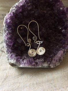 A personal favorite from my Etsy shop https://www.etsy.com/listing/234586042/sterling-silver-spiral-dangle-earings