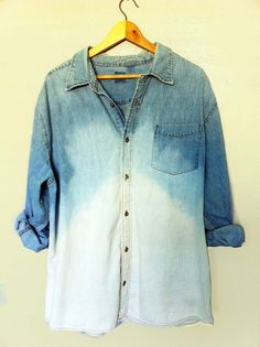 Gradient ombre bleached out denim shirt.  Create a bleach solution and dip shirt up to arm pits, then keep lower part of shirt in for longer. Make sure you do this outside, bleach fumes are strong!