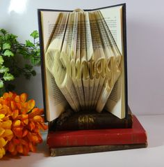Book Folding Art Paper Folding Book Sculpture by ThePinkPigVintage Book Folding, Paper Folding, Vintage Pins, Vintage Books, Book Sculpture, Leather Books, Personalized Books, Mixed Media Collage, Paper Decorations