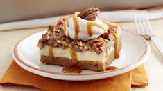 Everyone's fall favorites – pecan pie, cheesecake, pumpkin and caramel – come together in one indulgent layered dessert!
