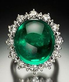 This emerald and diamond piece may be worn as a ring or pendant. The emerald is 19.41 ct, 17.70 x 15.80 x 10.00 mm and is one of the few emeralds in the collection to be enhanced (clarity). http://amzn.to/2tpDPX4