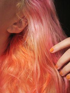 sunset hair. pink orange yellow colors. orange nails.