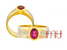 Stunning oval Burmese ruby and diamond Mokume Gane engagement ring. The intense pink sapphire or ruby is centrally bezel set in 18ct yellow gold with grain set round brilliant cut white diamonds either side. The parallel mokume gane ring band features 18ct white gold and silver with and 18ct yellow gold lining. Handmade with love in Hobart, Tasmania...home of Metal Urges Australia.