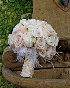Love the lace wrap, pearl details, and hint of feathers! Blush pink flowers are darling!
