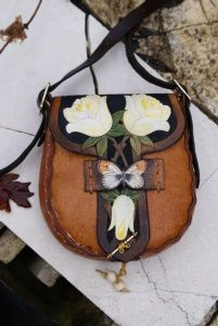 white roses and orange tip butterfly on an intricately carved and hand coloured bag