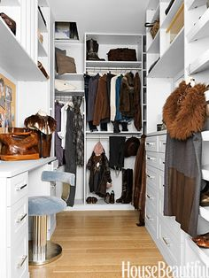 A spiffy Brunello Cucinelli wardrobe is beautifully organized in this design by California Closets.