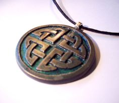 Aged bronze celtic pendant. £6.00, via Etsy.