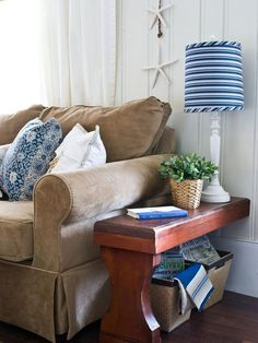 We all have hand-me-down pieces that, with just a little imagination, could be put to good use as something new. Designer Layla Palmer turned an old deacon's bench into matching end tables by simply cutting the bench in half and attaching the cut ends to the wall using a hidden bracket.