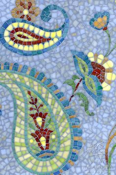 Paisley Vine, a hand cut jewel glass mosaic shown in Chalcedony, Citrine, Peridot, Aventurine, Carnelian,Tiger's Eye, Peacock Topaz, Quartz and Amber by Sara Baldwin for New Ravenna Mosaics, was shown at Cersaie 2012 in Bologna, Italy.