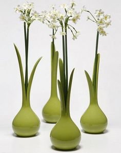 Vessels that mimic organic form, complimented by the addition of simple flora.