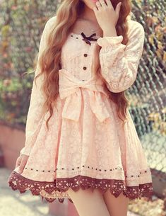 Lace dress, love the mixture of pink and brown.