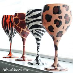 This set of 4 charming 20 oz wineglasses come in Cheetah, Zebra,Tiger and Giraffe print . Diy Wine Glasses, Decorated Wine Glasses, Hand Painted Wine Glasses, Funky Glasses, Wine Safari, Giraffe Print, Zebra Print, Safari Theme, Zebras