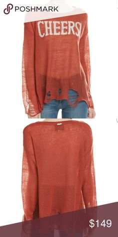 ??NWT?? Wildfox Cheers Wool Blend Sweater Wildfox!!!! New for Fall. Cheers graphic at front, ribbed neckline,  heavily distressed.  56%acrylic,  34% nylon,  10% wool color is: fox fur Wildfox Sweaters