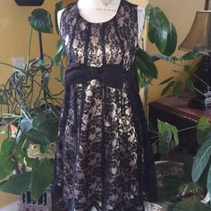 Black lace dress with pink satin lining and bow Cute day to night lace dress with bow in front and back zipper closure. Size M Forever 21 Dresses