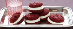 Red Velvet Whoopie Recipe.......1 box of Duncan Hines Red Velvet Cake Mix, 1/2 cup butter, 2 eggs......Melt butter and cool. Mix cool butter, eggs, and cake mix by hand until well blended. wrap up dough and refrigerate 1 hour. Use a 1 inch cookie scoop to make balls and cook on ungreased cookie sheet pan at 350 for 13-15 minutes. Frosting.......1-8 oz. package of cream cheese, 1/4 cup butter, 1 tsp. vanilla, 4 cups powdered sugar. Mix together and pipe between 2 cookies.