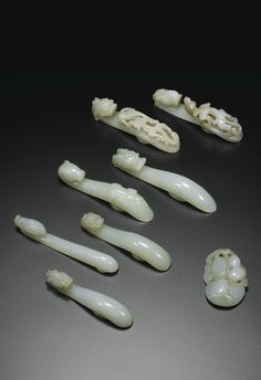 JP: SEVEN WHITE JADE BELT-HOOKS AND A JADE PENDANT, CHINA, QING DYNASTY, 18TH/19TH CENTURY