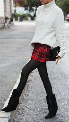 Shop this look on Lookastic:  http://lookastic.com/women/looks/turtleneck-skater-skirt-clutch-tights-mid-calf-boots/8815  — White Knit Turtleneck  — Red Plaid Skater Skirt  — Black Leather Clutch  — Black Wool Tights  — Black Suede Mid-Calf Boots