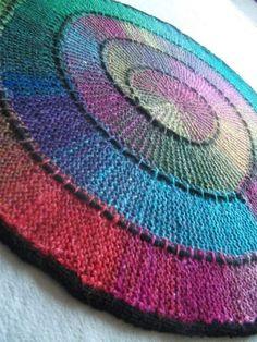 """Spiral blanket; similar-looking pattern found on ravelry under """"Ten stitch twist"""" by Frankie Brown."""
