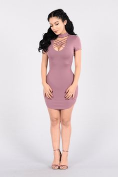 - Available In Black And Mauve - Crepe Mock-Neck Dress - Chest Cross Strap Detail - Back Neck Button Closure - Scoop Hem - Made In USA - 96% Polyester 4% Spandex