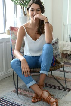 The simplicity of the scalloped blouse tank with cuffed jeans and strappy heels…