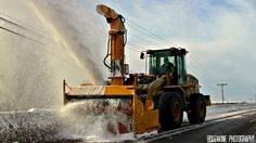Cat front loader working hard to keep the roads clear #CatMachines
