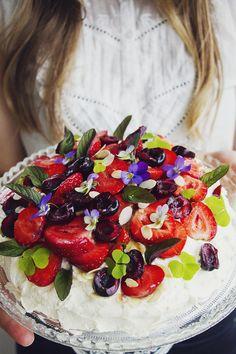 midsummer cream cake with Vanilla cream strawberries, cherries, mint and edible flowers.