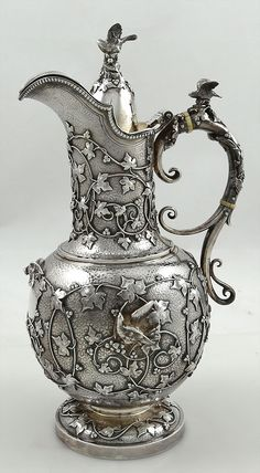 Fine antique silver chocolate pot by Tiffany and Company with applied cast vines…