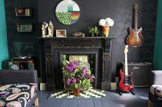 Rock n Roll living room. Love the black wall and black floor.