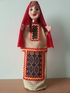 A handmade puppet in Armenian traditional mini-garment available on Etsy