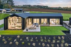 Designed to capture stunning views, this stunning showhome is built for all families to enjoy. Modern Barn House, Barn House Plans, Modern House Plans, Modern House Design, New Zealand Houses, Casas Containers, Shed Homes, Container House Design, Courtyard House