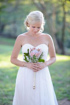 Single protea bouquet | SouthBound Bride | http://www.southboundbride.com/rustic-riverside-lowveld-wedding-by-kim-tracey | Credit: Kim Tracey