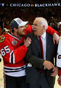 Andrew Shaw #65 and Joel Quenneville