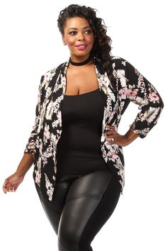 This stylish plus size jacket features a floral print body, elastic trimmed sleeves and open front. Soft, stretch material 95% Polyester 5% Spandex Imported