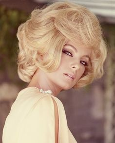 Virna Lisi, Italian actress, wearing a yellow top with slashed sleeves, with a blonde bouffant hairstyle, circa 1960. via @stylelist