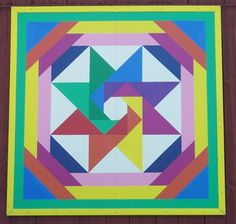 Judy Martin's Star of the Orient quilt block on a barn (Scrap Quilts, 1985)