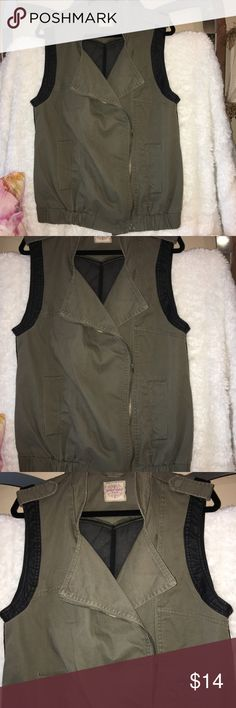 """Olive & Black zip up Cargo vest w/pockets size XL Olive green an black zip up cargo vest with two front pockets. Armholes trimmed in faux leather and the back is a back is a black sheer see through fabric. Size XL and measures 21"""" from arm pit to arm pit, measures 18"""" across the bottom which does have stretch to it. Measures 29"""" from shoulder to hem. By Highway Jeans. Excellent condition. Has not been worn Once but no tags. Highway Jeans Jackets & Coats Vests"""