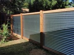 Perfect Metal Fence Ideas 10 Galvanized Sheet Metal Corrugated Metal Fence Capped In Cedar With 4x4