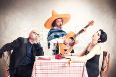 bored couple at dinner oblyed to listen to a mexican musician royalty-free stock photo