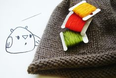 How to embroider your hand knits. I use this same basic method, but I trace my design onto tissue paper.