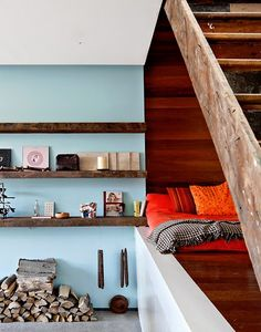 Nice shelves with blue wall