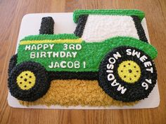 "3D Tractor Cake - Cake is carved from a half  sheet cake.  Tires are double-stacked 6"" and 4"" rounds.  All BC icing."