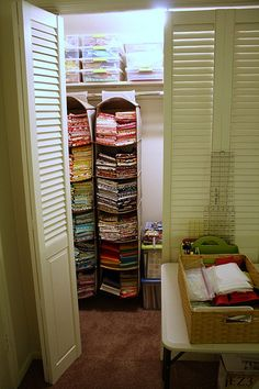 Clever use of a closet - I'd have to get rid of clothes to find room for those hangers....