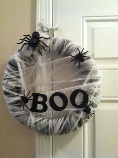 DIY- Halloween Wreath. -Styrofoam tubing painted black- white or glow in the dark spider webbing & spiders. Super easy!
