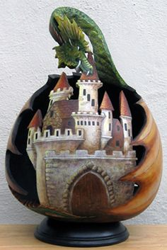 A dragon and a fairytale castle in this carved gourd art piece by Cyndee Newick.