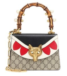 Gucci - Broche GG Supreme Mini leather shoulder bag - The fox is a symbol of cleverness and is a reoccurring symbol presented in Gucci's SS17 collection, and it sits proudly atop the Broche shoulder bag's leather flap. Featuring the label's signature GG canvas, a faux-pearl encrusted bamboo handle, and a jewellery-influenced chain shoulder strap, this piece is sure to stand out whether you carry it to the office or on a dinner date. seen @ www.mytheresa.com