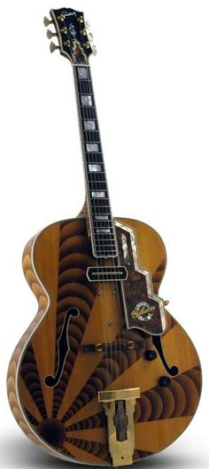 L-5 Auburn another of those lovely anniversary Gibson Archtops --- https://www.pinterest.com/lardyfatboy/